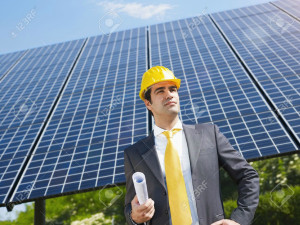 Engineer-holding-blueprints-in-solar-power-station